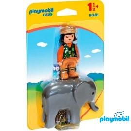 Cuidadora con Elefante 123